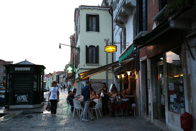 Restaurant shopfront in Venice alongside a canal